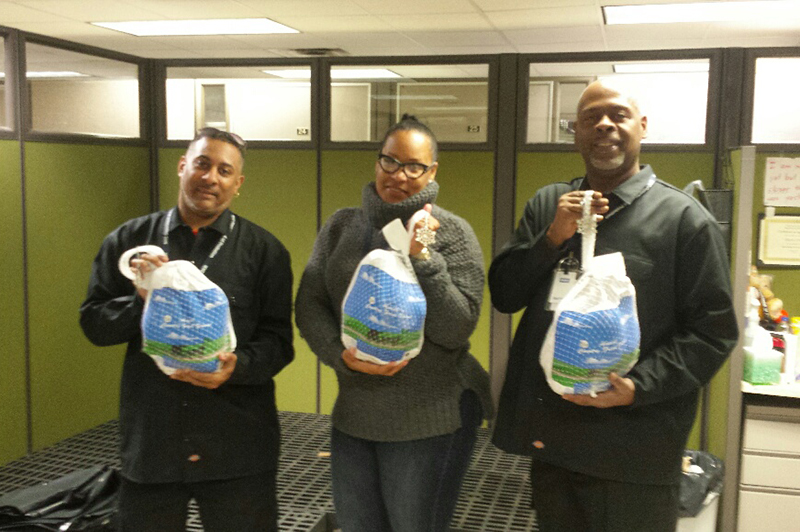 Bronx Turkey Giveaway with Three People Holding Turkeys
