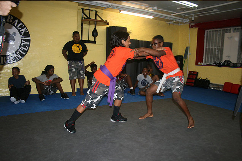 NeON Sports participants practicing martial arts