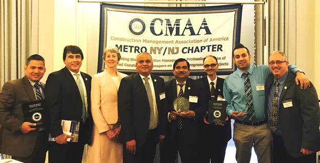 NYCHA staff receiving the award for Excellence in Project Management by the Construction Management Association of America
