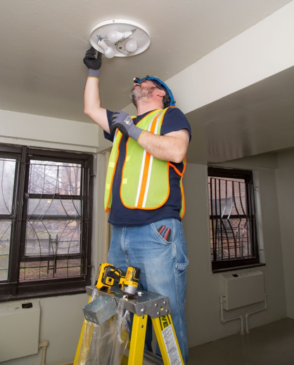 Worker Installs New Lighting - low angle