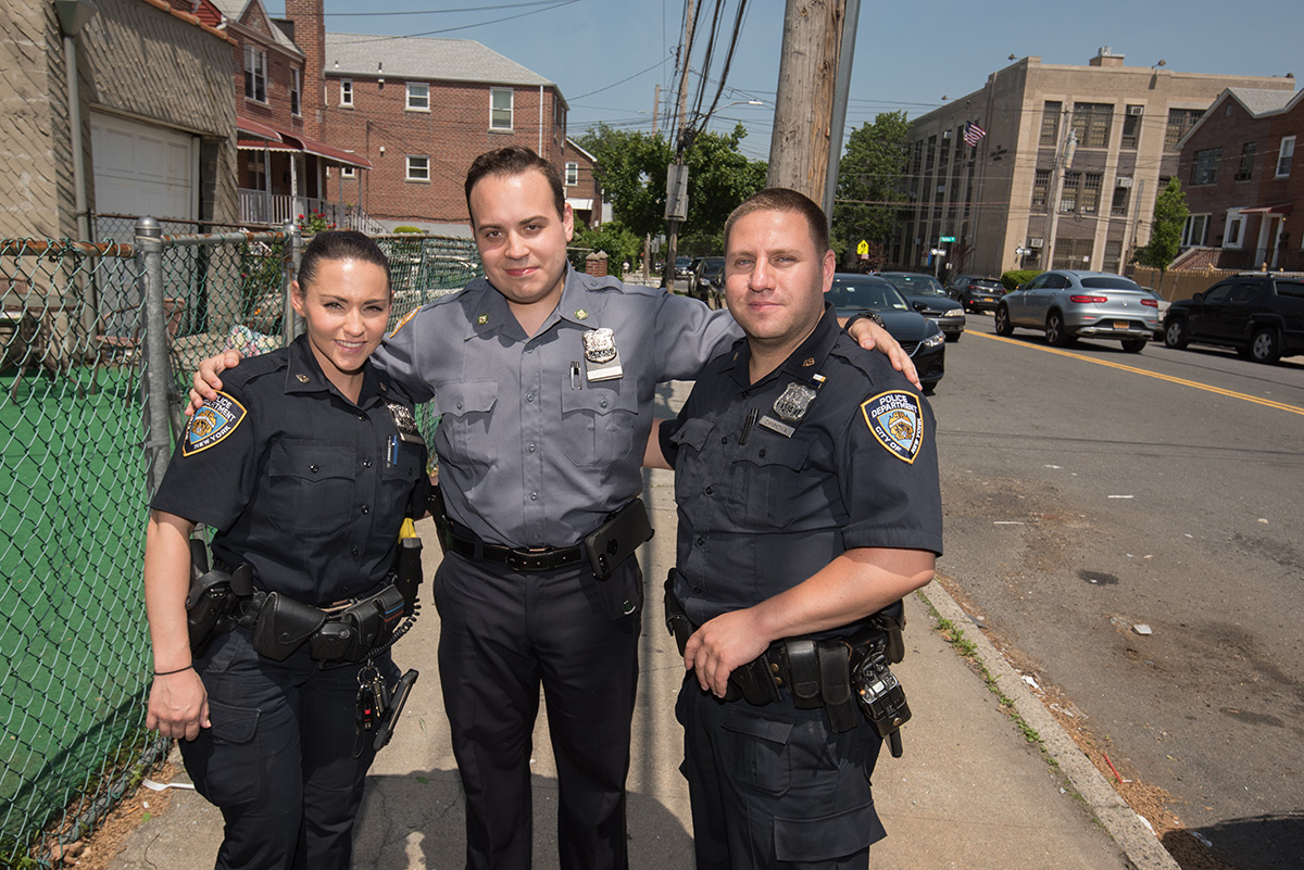Cannova and Varela posing on the street with NYPD recruit Eric Santiago