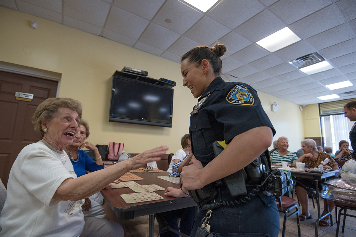 Varela chatting with elderly community members