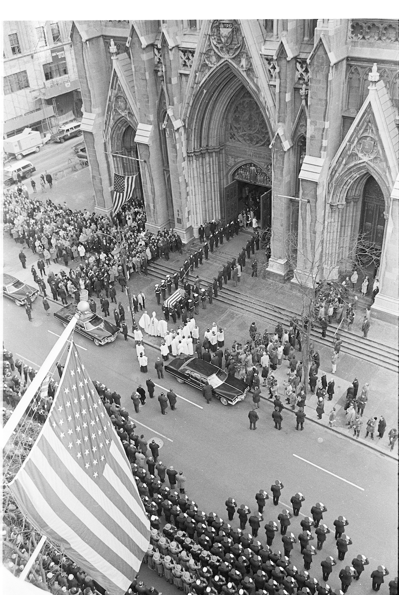 Arial view of funeral processsion outside St. Patrick's Cathedral, police officers saluting