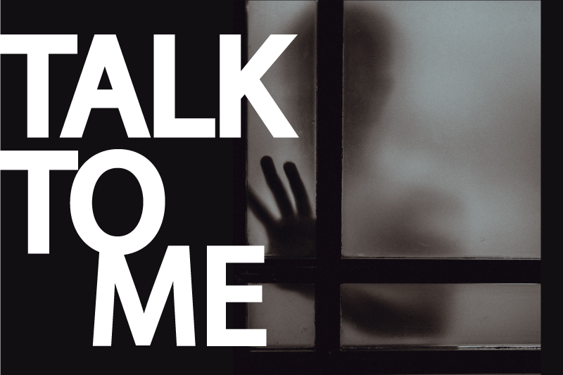 "The words ""Talk to Me"" over a blurry silhouette of a person with their hand against a window"
