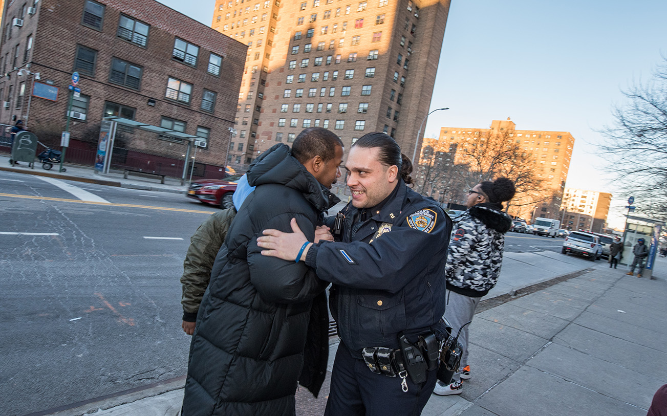 Police officer hugs a resident