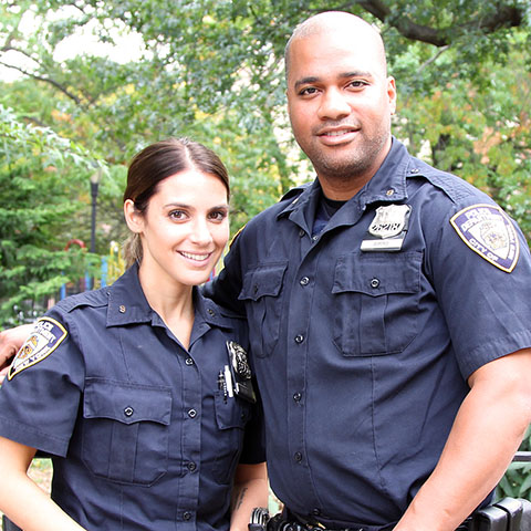 Smiling female and male police officers
