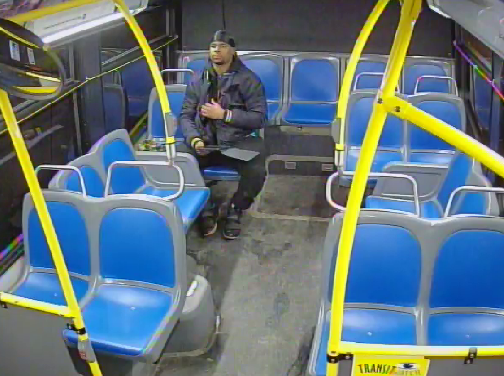 Surveillance footage of suspect on bus with iPad