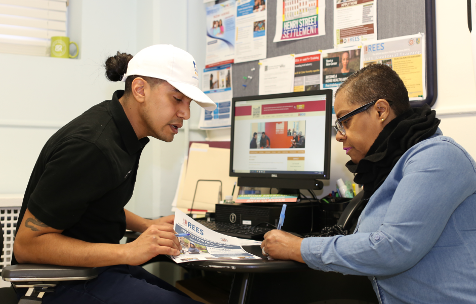 Employee of Jobs-Plus assisting a NYCHA resident with application