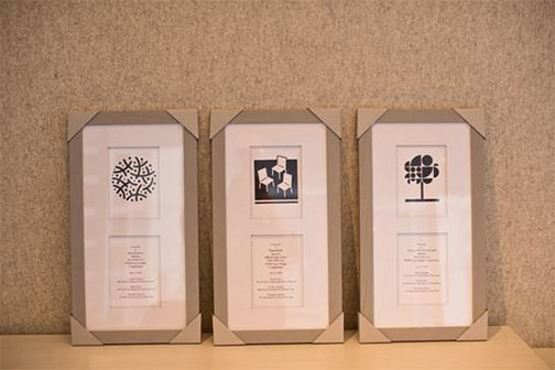 "(from left to right) The three awardees: ""Constellation"" by John Schettino, ""Have a Seat"" by Emma Reed (the new POPS logo), and ""More Than a Tree"" by Gensler NYC Brand Design Studio"