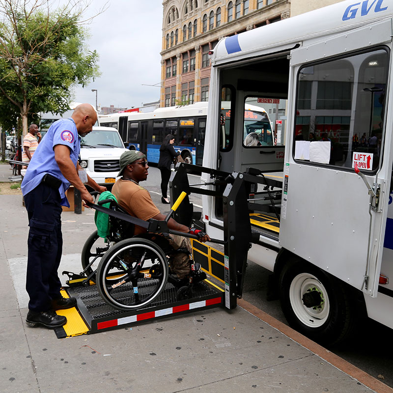Person in a wheelchair entering a vehicle