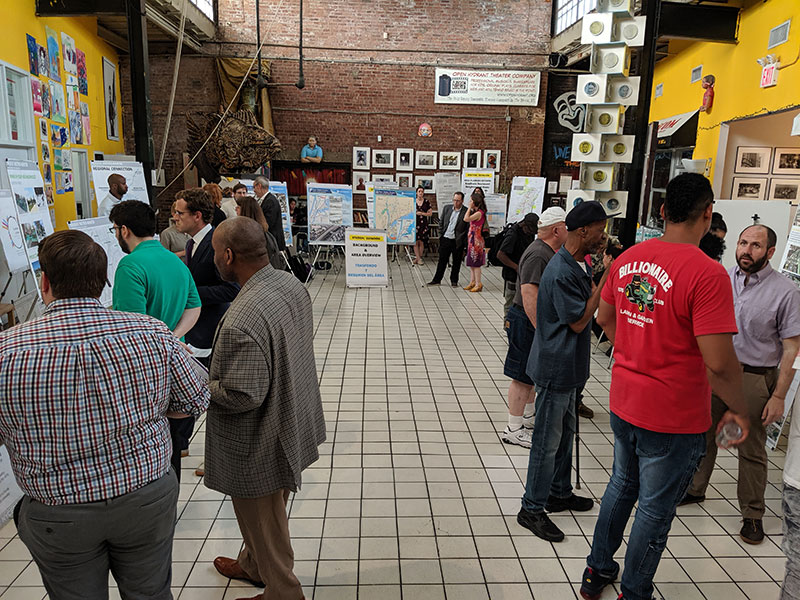 Members of the public discuss future service and their vision for Hunts Point during a public event at The Point.