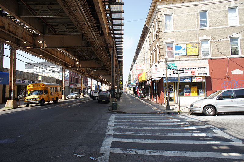 Fulton Street is a local retail corridor with the elevated J/Z train running above ground.