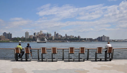 Bar stools looking towards East River and Brooklyn