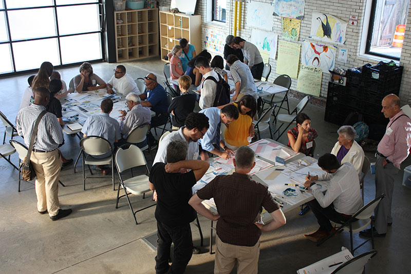 In the Rockaways, participants at a workshop creating their flood resilient building design