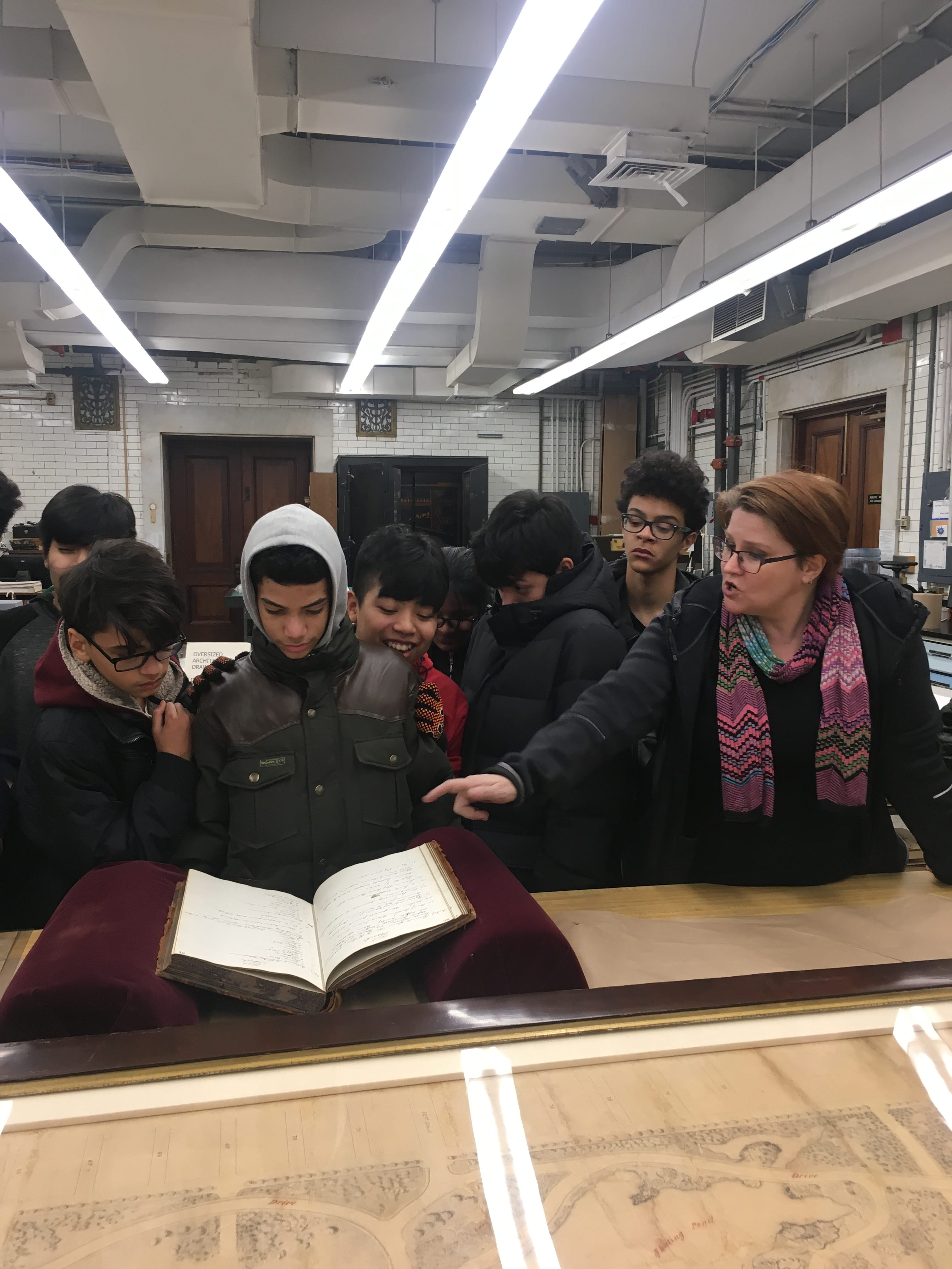 High School Students looking at documents in the Municipal Archives Conservation Lab.