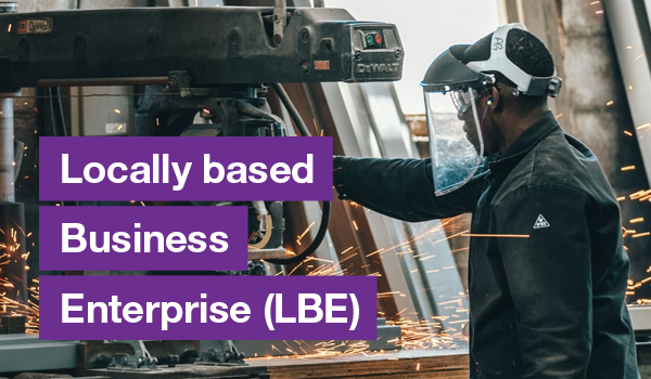 Black man using construction equipment with text on the left that says Locally based Business Enterprise (EBE)