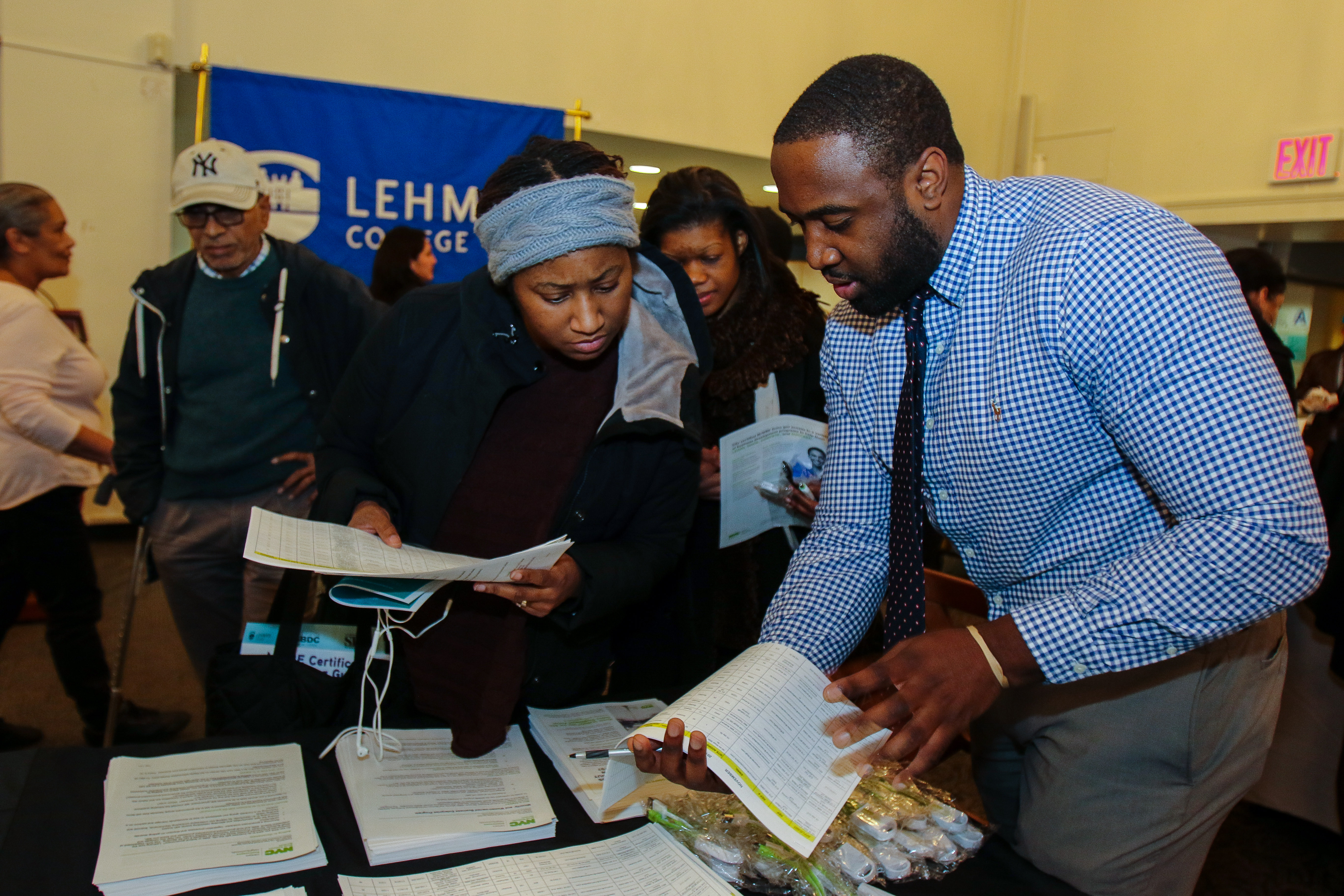 Man showing a woman resource information at an event for businesses