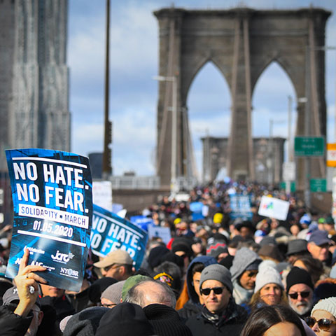 New Yorkers rally against anti-Semitism and hate on the Brooklyn Bridge