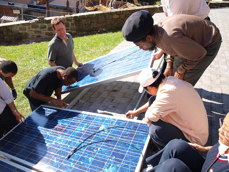 CUNY Bronx Community College students learn to install solar panels in a hands-on training class