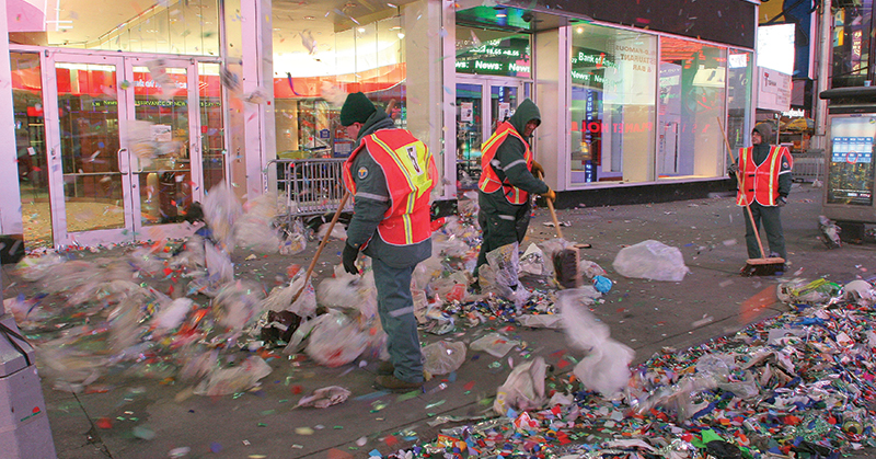 New York City Sanitation workers cleaning up street following New Years Day Parade