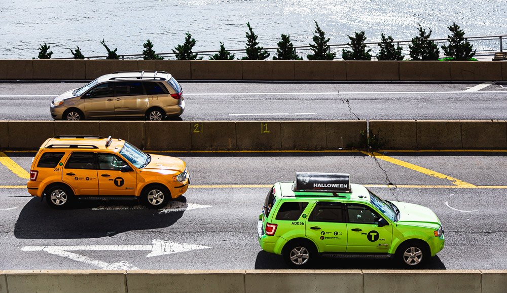 Image of yellow and green taxis