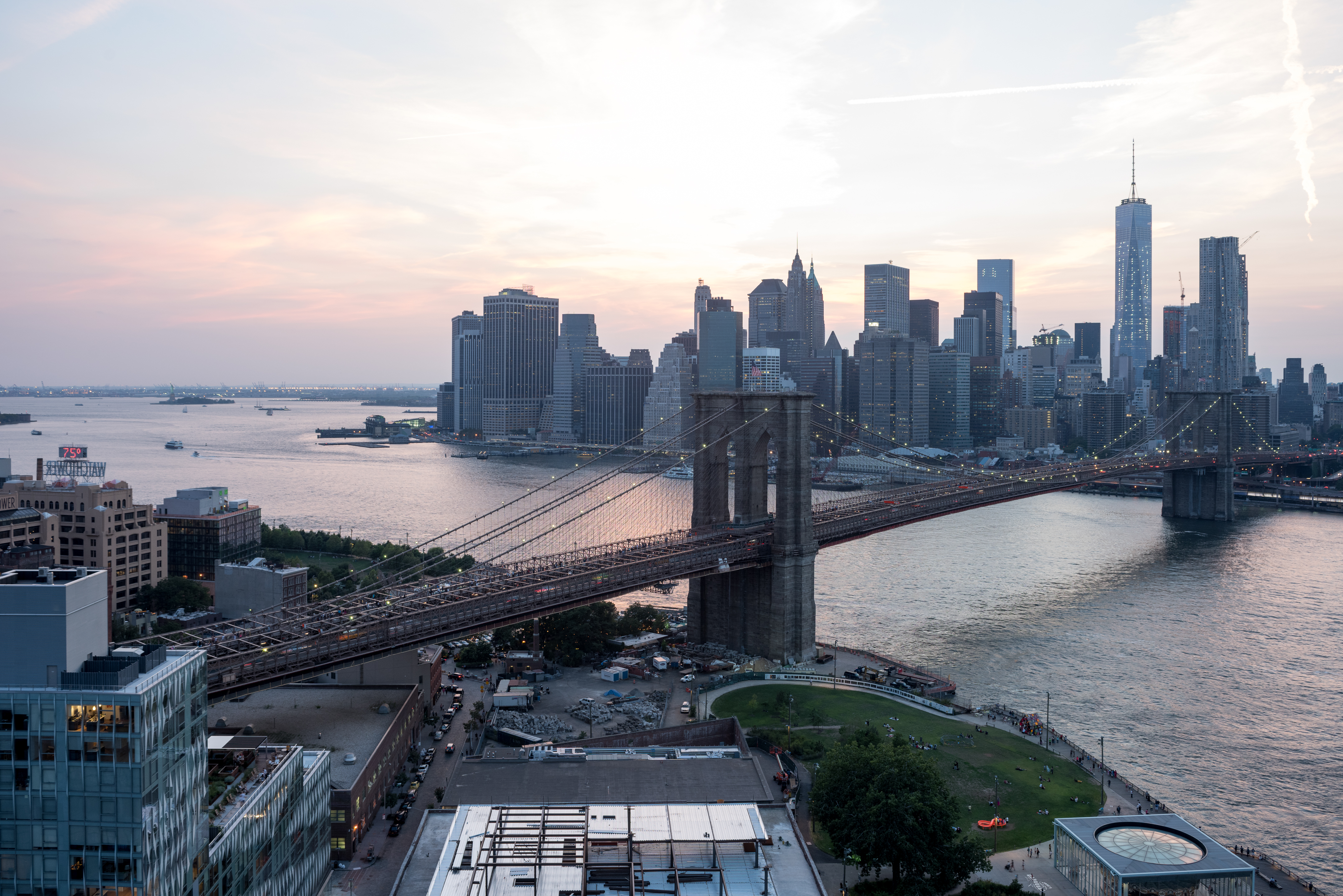 Sunset view of Brooklyn Bridge and New York City