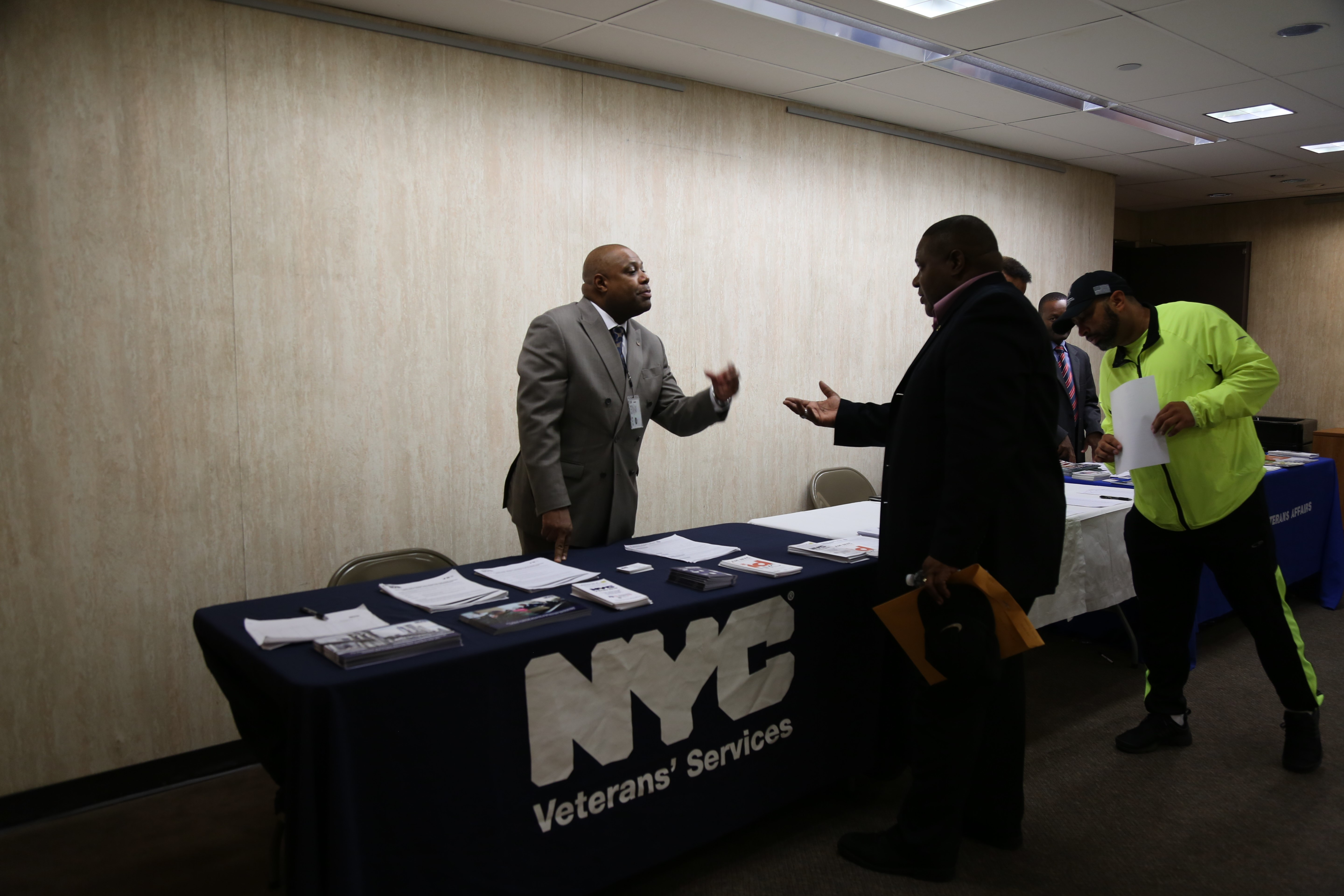 DVS outreach specialist stands behind resource table while engaging a constituent during community outreach event.