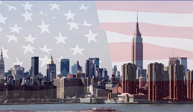 NYC skyline with overlay of American flag
