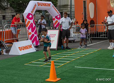 Sponsor hosts Sports Zone football drills during Summer Streets