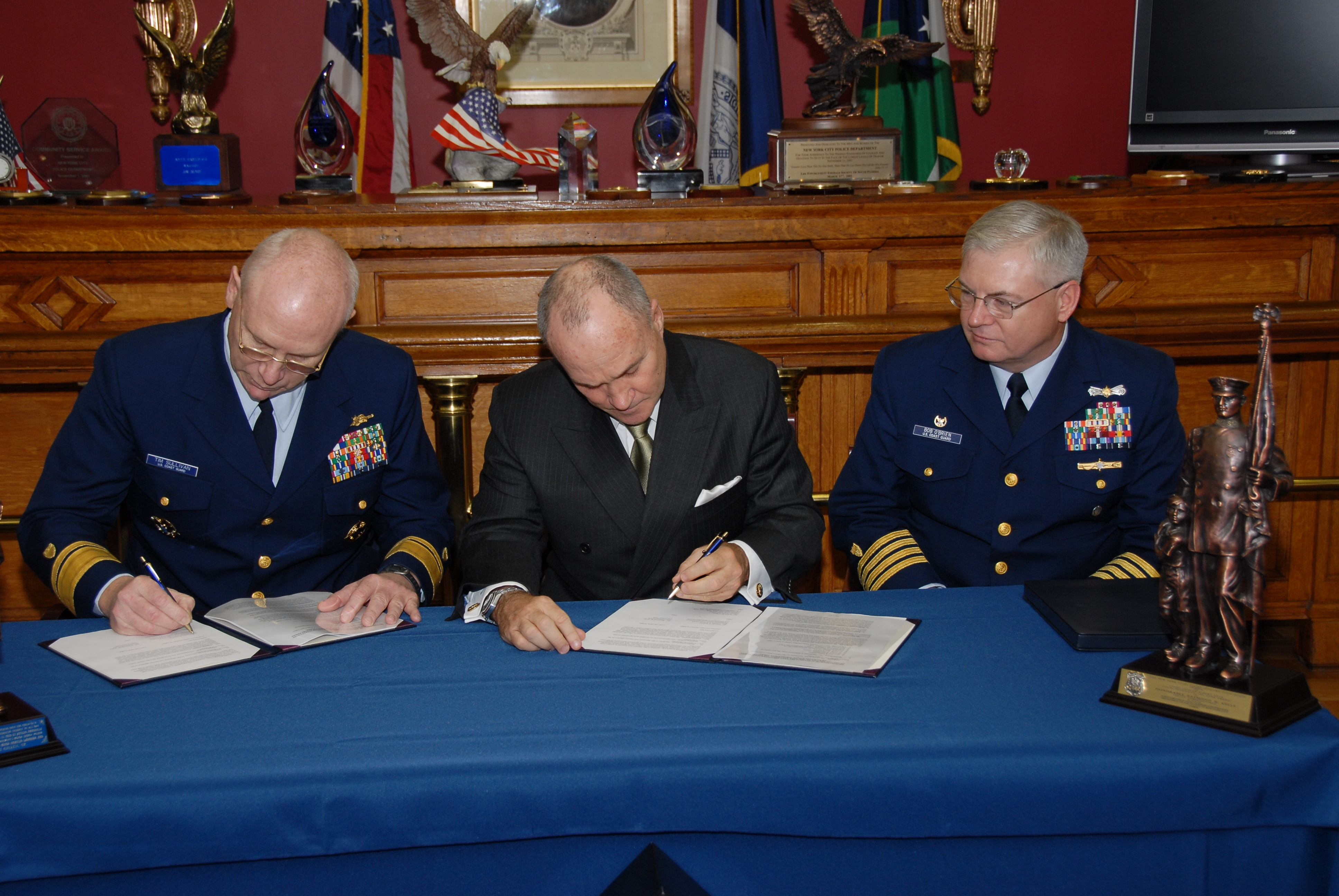Photo u s coast guard rear admiral timothy s sullivan new york city police commissioner raymond w kelly and u s coast guard captain robert r o brien